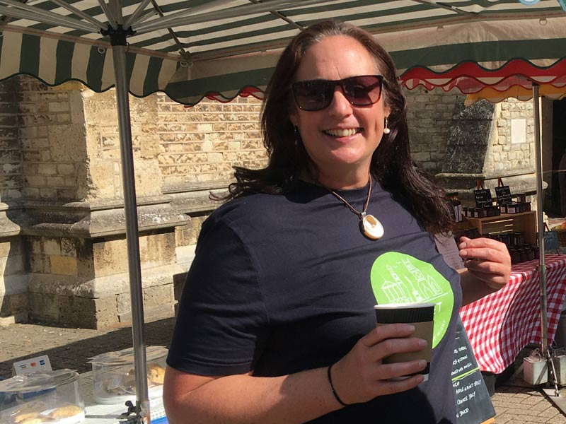 Claire standing in front of market stall