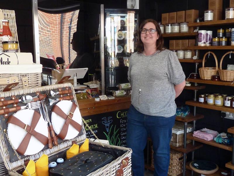 person inside the Little Nook shop